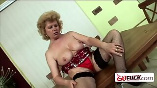 Granny gets down and dirty with horny stud who makes her suck and take cock