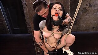 Hogtied Asian in suspension toyed
